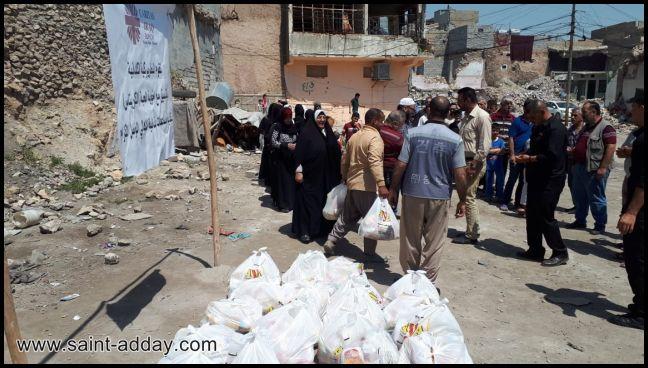 اخوية المحبة في دهوك توزع سلات غذائية للعوائل المتعففة في الموصل القديمة 002