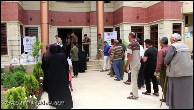اخوية المحبة في دهوك توزع سلات غذائية للعوائل المتعففة في الموصل القديمة 003