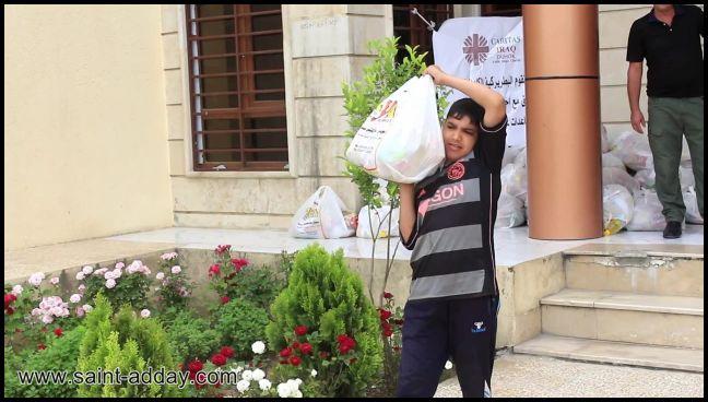 اخوية المحبة في دهوك توزع سلات غذائية للعوائل المتعففة في الموصل القديمة 004