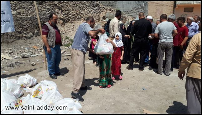 اخوية المحبة في دهوك توزع سلات غذائية للعوائل المتعففة في الموصل القديمة 005